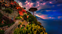 """""""Evening view from the deck of Hotel California Positano""""…<br /> <br /> After an exhilarating drive along the high cliffs on the Amalfi coast from Sorrento down to Positano, I found myself in sensory overload with its beauty and photogenic appeal.  After circling around the entire village and its cliffside three times on Positano's only street, which was a single lane winding down from the top and back up and over to where I began, I finally found the parking garage by the hotel, about 2/3rds up the facing village in this image.  The climb down the winding road and steep staircases made for quite a workout in the hot late May sun.  Reaching the beach and marina, I forgot about my exhaustion and could not capture enough of Positano's plush beauty; however, the large amount of tourists and bright sun did not allow for ideal conditions.  Walking the length of the beach, I found a very, very steep staircase leading straight up to a large veranda at the Albergo California.  Taking an exhaustive seat on a plush lounge chair with a perfect view to watch the sunset behind the Amalfi Cliffs, I was taken back by a pleasant Italian (Positano) waiter from the hotel offering a towel, ice water, and drinks for the evening.  I expressed that I was not staying at the hotel, but he didn't seem to mind and proceeded to educate me on the culture of this historic resort village.  After a brief rest, I wandered around taking full advantage of Albergo California's 180 degrees of seaside vistas.  Turning southward looking down the Amalfi Coast, the seaside town of Praiano began to appear ominous as storm clouds formed above creating a dramatic panorama."""