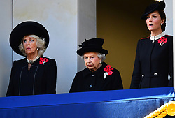 The Duchess of Cornwall, Queen Elizabeth II and the Duchess of Cambridge during the remembrance service at the Cenotaph memorial in Whitehall, central London, on the 100th anniversary of the signing of the Armistice which marked the end of the First World War.
