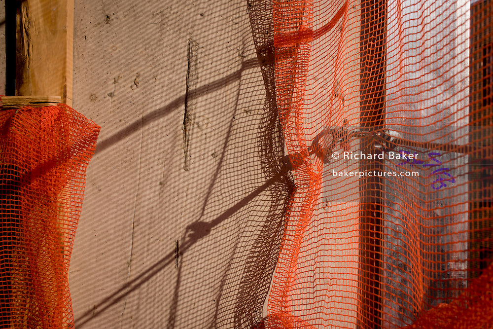 Construction netting on New York City construction site.