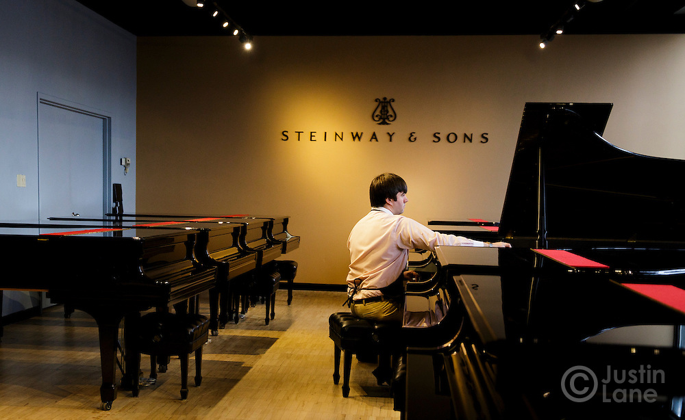 Erik Diehl, a concert technician, checks the sound and tuning of completed pianos in a small showroom at the Steinway and Sons piano production facility in Astoria, New York, USA, 04 April 2016. Each piano at the factory is built and assembled by hand, a process the company has been refining since being founded in 1853 in New York. In the late 1800s, there were hundreds of piano manufacturers in the United States, but Steinway and Sons is now one of only a few companies still making the instrument.