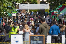 © Licensed to London News Pictures. 30/05/2021. London, UK. Public enjoy the sunny weather during bank holiday in Victoria Park Market, east London.  Photo credit: Marcin Nowak/LNP