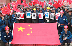 October 1, 2018 - Huaying, Huaying, China - Huaying, CHINA-Coal miners pose for a group photo with the national flag of China in Huaying, southwest China's Sichuan Province, September 30th, 2018, celebrating the National Day of China. (Credit Image: © SIPA Asia via ZUMA Wire)