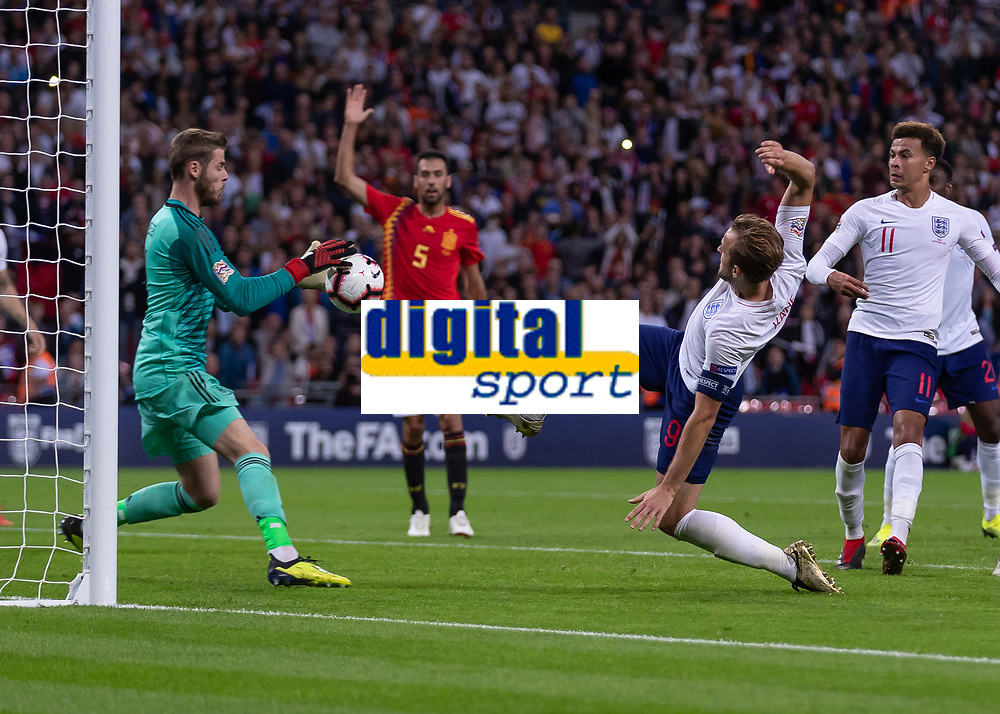 Football - 2018 / 2019 UEFA Nations League A - Group Four: England vs. Spain<br /> <br /> Harry Kane (England) with a desperate lunge to reach the ball infront of David de Gea (Spain) at Wembley Stadium.<br /> <br /> COLORSPORT/DANIEL BEARHAM