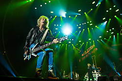 © Licensed to London News Pictures . 15/12/2015 . Manchester , UK . RICK SAVAGE . Def Leppard perform at the Manchester Arena . Photo credit : LNP