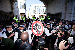 © Licensed to London News Pictures. 15/10/2011. LONDON, UK. Protesters stand outside St Pauls Cathedral at the beginning of Occupy The London Stock Exchange. Photo credit: Matt Cetti-Roberts/LNP