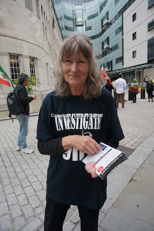 The demonstrator is calling for an investigation into the 20th anniversary of 911 tomorrow. They believe it is self-destruction and internal jobs alleges BBC cover up. Justice for the victims, Truth for the world in front of BBC on 2021-09-10, London, UK.