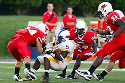 10 September 2011: Josh Howe latches on to Desmond Cox as Mike Banks and Shelby Harris arrive to help during an NCAA football game between the Morehead State Eagles and the Illinois State Redbirds at Hancock Stadium in Normal Illinois.