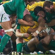 Will Genia, Australia, is tackled by Mike Ross, Ireland, during the Australia V Ireland Pool C match during the IRB Rugby World Cup tournament. Eden Park, Auckland, New Zealand, 17th September 2011. Photo Tim Clayton.....