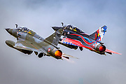 two France Air Force MIRAGE 2000 in flight. Photographed at Royal International Air Tattoo (RIAT)
