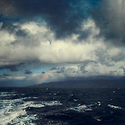 View of the island Madeira from a ferry on its way to Porto Santo on a stormy day