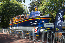 © licensed to London News Pictures. London, UK 20/09/2013. 14 tonne RNLI (Royal National Lifeboat Institution) lifeboat being pulled by teams through London's Hyde Park. An 11.6 metre Mersey class lifeboat on a lorry with a combined weight of 37 tonnes being pulled by 10 teams of 8 people from a range of organisations in a charity event that hopes to raise at least £20,000 to help save lives at sea. Photo credit: Tolga Akmen/LNP