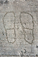Petroglyph, rock carving, of two feet outlines. Carved by the ancient Camuni people in the iron age between 1000-1200 BC. Rock no 24, Foppi di Nadro, Riserva Naturale Incisioni Rupestri di Ceto, Cimbergo e Paspardo, Capo di Ponti, Valcamonica (Val Camonica), Lombardy plain, Italy .<br /> <br /> Visit our PREHISTORY PHOTO COLLECTIONS for more   photos  to download or buy as prints https://funkystock.photoshelter.com/gallery-collection/Prehistoric-Neolithic-Sites-Art-Artefacts-Pictures-Photos/C0000tfxw63zrUT4<br /> If you prefer to buy from our ALAMY PHOTO LIBRARY  Collection visit : https://www.alamy.com/portfolio/paul-williams-funkystock/valcamonica-rock-art.html