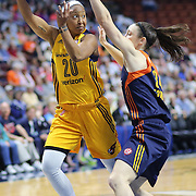 UNCASVILLE, CONNECTICUT- JUNE 5:  Briann January #20 of the Indiana Fever passes over Kelly Faris #34 of the Connecticut Sun during the Indiana Fever Vs Connecticut Sun, WNBA regular season game at Mohegan Sun Arena on June 3, 2016 in Uncasville, Connecticut. (Photo by Tim Clayton/Corbis via Getty Images)