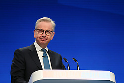 © Licensed to London News Pictures. 04/10/2021. Manchester, UK.  Secretary of State for Levelling Up, Housing and Communities and Minister for Intergovernmental Relations Michael Gove speaks at the Conservative Party Conference on Monday. The annual Conservative Party Conference has returned to Manchester this year after being held online in 2020. Photo credit: Adam Vaughan/LNP