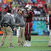 South Carolina Gamecocks defensive end Jadeveon Clowney (7) takes a drink of Gatorade during a timeout of the NCAA Capital One Bowl football game between the South Carolina Gamecocks who represent the SEC and the Wisconsin Badgers who represent the Big 10 Conference, at the Florida Citrus Bowl on Wednesday, January 1, 2014 in Orlando, Florida. (AP Photo/Alex Menendez)