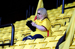 A Watford fan in the stands before the Premier League match at Vicarage Road, Watford.