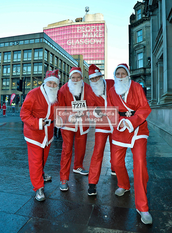 Glasgow MP's Patrick Grady, Alison Thewlis, David Linden and Stuart McDonald joined more than 8000 runners, all dressed as Santa, took part in the annual charity fun run thru the centre of Glasgow, to raise money for charity.<br /> <br /> © Dave Johnston/ EEm