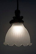 glass lamp shade with light on