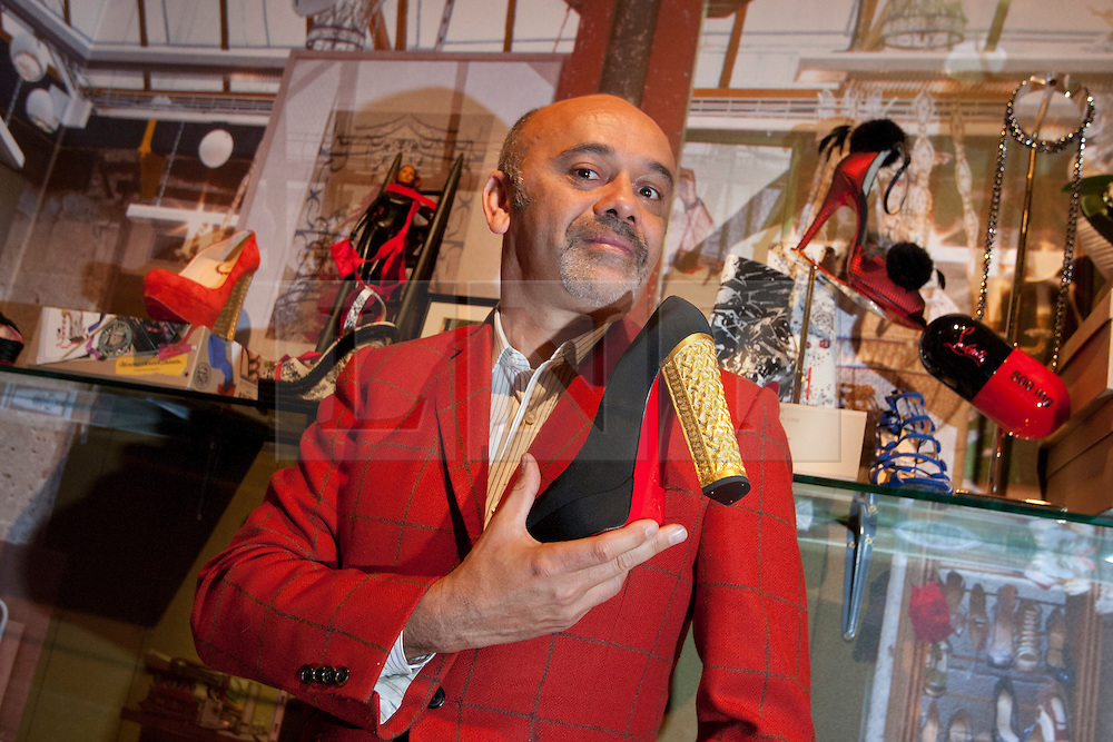 © licensed to London News Pictures. London, UK 30/04/2012. Christian Louboutin posing with a shoe before as he opens his exhibition, which celebrating 20 years of the famous red soled footwear brand at Design Museum in London. Photo credit: Tolga Akmen/LNP