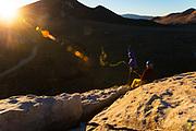 Scott Bennett rapping off Rye Crisp 5.8 at sunrise, Elephant Rock, City of Rocks, Idaho