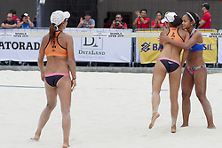 May 5, 2018 - Pasay, National Capital Region, Philippines - The first day of FIVB (Fédération Internationale de Volleyball) Beach Volleyball World Tour, Manila Open 2018, with its third day for women's quarter finals. Games are held on Sands SM by the Bay area of SM Mall of Asia...Its Philippines versus Japan for the quarter finals. Philippines team in blue top are (1) Cherry Ann Rondina and (2) Angeline Marie Gervacio. Japan team in orange top are (1) Shinako Tanaka and (2) Sakurako Fuji...Angeline Marie Gervacio hugs Sakurako Fuji in an acknowledgement of sportsmanship after Japan wins in this intenese game of beach volleyball. (Credit Image: © George Buid via ZUMA Wire)