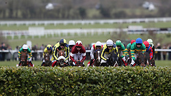 Tiger Roll ridden by jockey Keith Donoghue (centre left, maroon and white silks) in action in the Glenfarclas Chase during Ladies Day of the 2018 Cheltenham Festival at Cheltenham Racecourse.