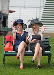 © Licensed to London News Pictures. 21/06/2012. Ascot, UK Women wave at the camera. Ladies Day at Royal Ascot 21st June 2012. Royal Ascot has established itself as a national institution and the centrepiece of the British social calendar as well as being a stage for the best racehorses in the world.. Photo credit : Stephen Simpson/LNP
