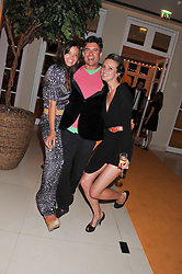 Left to right, LADY NATASHA RUFUS-ISAACS, EDWARD TAYLOR and BRYONY DANIELS at the Veuve Clicquot Experience at The Hurlingham Party following the Polo in The Park held at the Hurlingham Club, London SW6 on 8th June 2012.