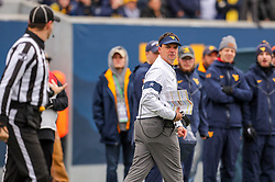 Nov 23, 2019; Morgantown, WV, USA; West Virginia Mountaineers head coach Neal Brown argues a call along the sidelines during the second quarter against the Oklahoma State Cowboys at Mountaineer Field at Milan Puskar Stadium. Mandatory Credit: Ben Queen-USA TODAY Sports