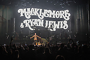 """WASHINGTON, DC - November 18, 2013 - Macklemore and Ryan Lewis  perform at the Verizon Center in Washington, D.C. The duo is still riding high off of their 2012 album, The Heist, which contains the #1 singles """"Thrift Shop"""" and """"Can't Hold Us."""" (Photo by Kyle Gustafson / For The Washington Post)"""
