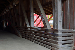 24 October 2017:  The Bridgeton Mill and Covered Bridge.  interior shot of bridge with mill visible through a window.<br /> <br />  Parke County Indiana is the site of the Indiana Covered Bridge Festival every October
