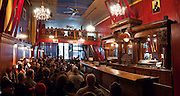 Doc Maynard's Public House, a restored 1890s saloon, 610 1st Avenue, Seattle, WA 98104, is featured on .Bill Speidel's Underground Tour beneath Pioneer Square-Skid Road Historic District, in the southwest corner of Downtown Seattle, Washington, USA.
