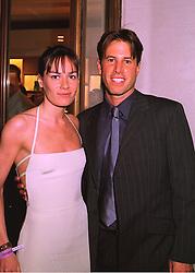MISS TARA PALMER-TOMKINSON and MR JOE SIMON at a party in London on 24th February 1998.MFP 52