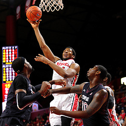 Kadeem Jack #11 of the Rutgers Scarlet Knights puts up a shot during the first half of Rutgers men's basketball vs Temple Owls in American Athletic Conference play on Jan. 1, 2014 at Rutgers Louis Brown Athletic Center in Piscataway, New Jersey.