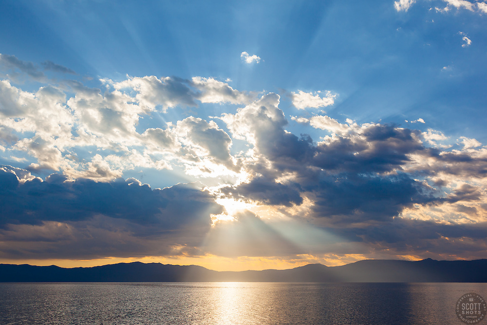 """""""Crepuscular Rays Over Lake Tahoe 1"""" - These crepuscular rays were photographed near sunrise over Lake Tahoe. Shot from a small fishing boat during the annual Jakes on the Lake charity fishing derby."""