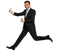 one caucasian business man running jumping double thumbs up in studio isolated on white background
