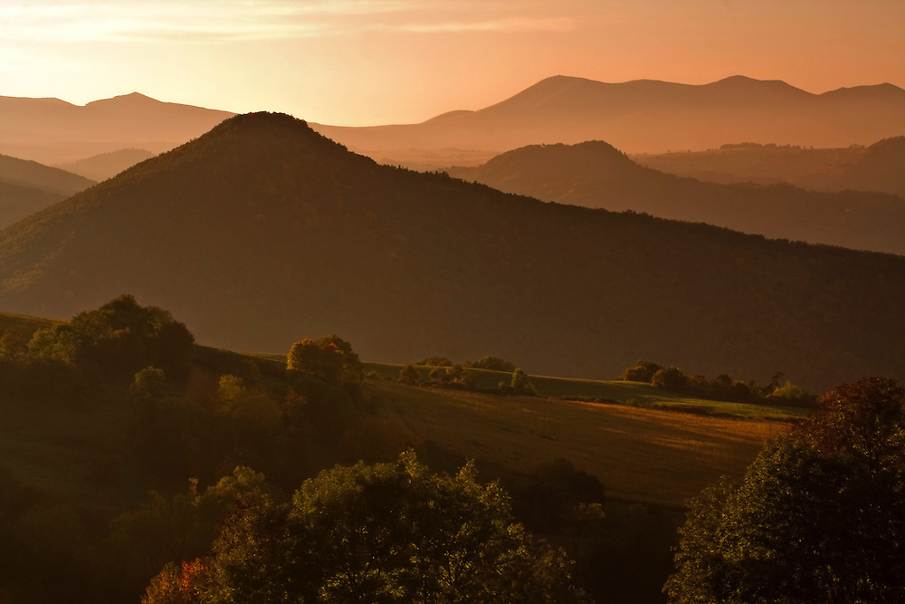 Sunset with orange light in autumn hill scenery