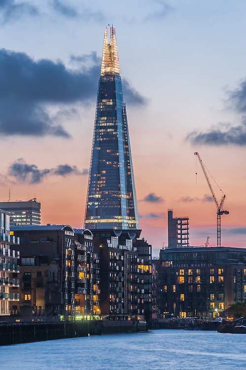 LONDON, UK - SEP 2: The Shard skyscraper by Renzo Piano illumiated during a deep red sunset in London on September2, 2014