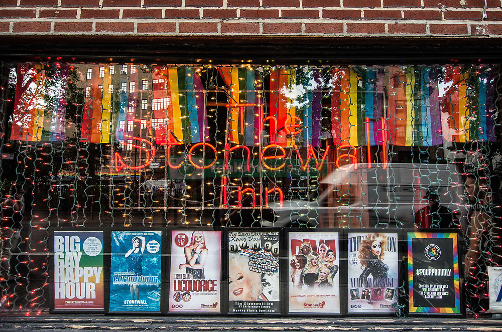 """August 26, 2017 - New York City, New York, United States of America - Facade of the Stonewall Inn. Dozens demonstrated for Kiwi Herring, a 30 year old trangender woman that was shot and killed by St. Louis police after a call from a neighbor. The demonstration eventually became a march that snaked through lower Manhattan, making stops at restaurants to deliver the message to the patrons.  At least one verbal altercation transpired. The family of Herring alleges that she was the victim of long-term harassment by a """"homophobic"""" neighbor, while the police allege that she held a knife and injured at least one officer with it.  Prior to the fatal incident, there was another knife incident on the premises involving Herring and a neighbor.  ..Currently, police are investigating and if non-lethal methods were used before the fatal shooting.  The Human Rights Campaign, a gay rights NGO, has stated that this is the 18th transgender killing this year, with nearly all the victims being people of color, and nearly all having been black.  Furthermore, just one day prior, Trump signed the bill banning transgender people from serving in the military. (Credit Image: © Sachelle Babbar via ZUMA Wire)"""