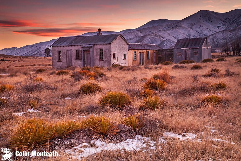 Dawn light, 1939 farm cottage (still in use as tea room for shearers), early winter snowfall on Hawkdun Range, St Bathans, Central Otago.