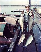 1006-G036A.  Walt Willard fishing in Winchester bay. About 1962