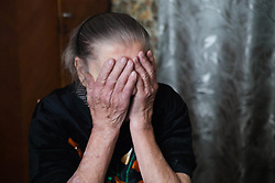 Varvara Tutunik, 91, covers her face as she recounts the fighting that recently raged around her apartment and across the city of Debaltsevo. Varvarva was evacuated with many thousands of others when the city became unsafe for civilians to remain. Now, some two months into a ceasefire, two MSF home visit teams are visiting elderly and sick patients across the city providing a lifeline of medical care and access to medicine.