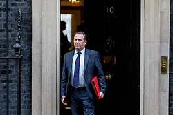 © Licensed to London News Pictures. 12/03/2019. London, UK. Secretary of State for International Trade Liam Fox leaves 10 Downing Street after the Cabinet meeting. MPs will get a second meaningful vote on Prime Minister Theresa May's Brexit deal this evening. Photo credit: Rob Pinney/LNP