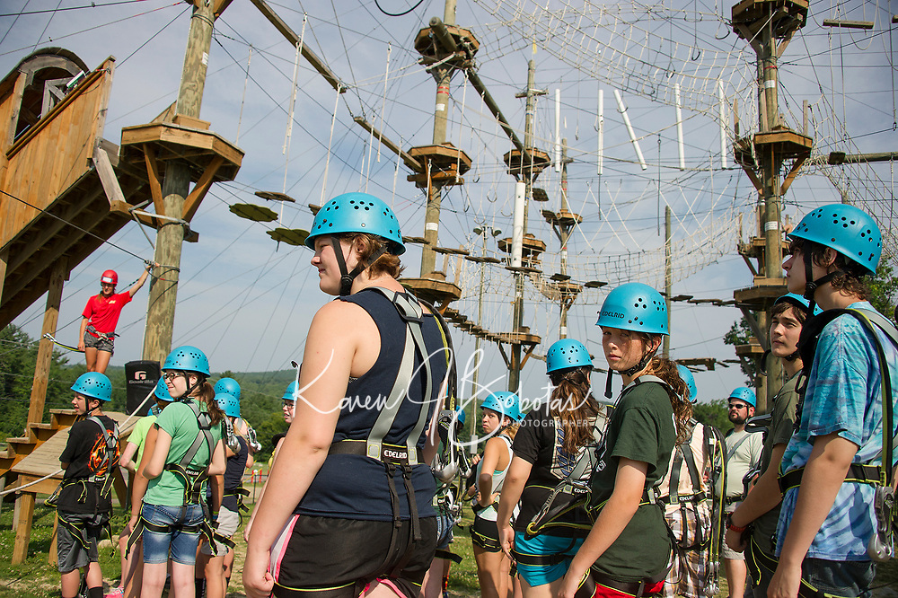 26 Newfound Bridge Academy students transitioning from middle school to high school (Newfound Regional High School) prepare to challenge the Monkey Trunks Rope Course on Thursday morning as one of their bonding experiences.  (Karen Bobotas/for the Laconia Daily Sun)