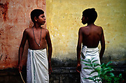 Boys wait for their examination at the Kerala Kalamandalam, Kerala, India<br /> The Kalamandalam was founded in 1930 to preserve the cultural traditions of Kathakali, the stylised dance drama of Kerala. Kathakali is the classical dance-drama of Kerala, South India, which dates from the 17th century and is rooted in Hindu mythology. Kathakali is a unique combination of literature, music, painting, acting and dance performed by actors wearing extensive make up and elaborate costume who perform plays which retell in dance form stories from the Hindu epics.