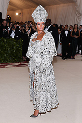Rihanna walking the red carpet at The Metropolitan Museum of Art Costume Institute Benefit celebrating the opening of Heavenly Bodies : Fashion and the Catholic Imagination held at The Metropolitan Museum of Art  in New York, NY, on May 7, 2018. (Photo by Anthony Behar/Sipa USA)