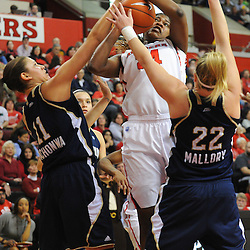 Notre Dame Fighting Irish forward Natalie Achonwa (11) blocks Rutgers Scarlet Knights forward/center Monique Oliver's (34) shot during second half NCAA Big East women's basketball action between Notre Dame and Rutgers at the Louis Brown Athletic Center. Notre Dame defeated Rutgers 71-41.