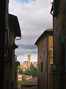 The church of Santa Maria dei Servi, also known as the church of San Clement, seen through the city streets of Siena, Tuscany, Italy