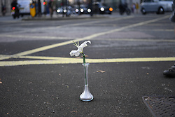 © Licensed to London News Pictures. 08/09/2021. London, UK. A lone flower commenting the death the death of Dr Marta Krawiec in Holborn. Supporters of London Cycling Campaign (LCC) ride to the junction where she was killed, along a route featuring several of London's other deadly junctions left for years without appropriate safety interventions. The campaign is demanding an end to delays over action on junctions known to be dangerous, and lethal to cyclists for years. <br /> <br /> Dr Krawiec died in a crash with an HGV on a notorious blackspot at the junction of Southampton Row and Theobalds Road, near Holborn Tube station on the 4th of August and is the 7th cyclist to have been killed at the junction in 13 years<br /> <br /> Photo credit: Guilhem Baker/LNP