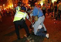 Lisbona - Lisboa 12/6/2004 <br />Police pull in an English fan at Rossio Place. <br />La polizia portoghese ferma un tifoso inglese. <br />Photo Graffiti